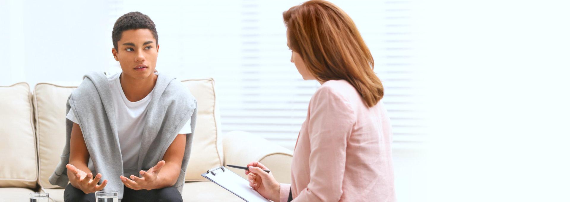 boy talks with therapist