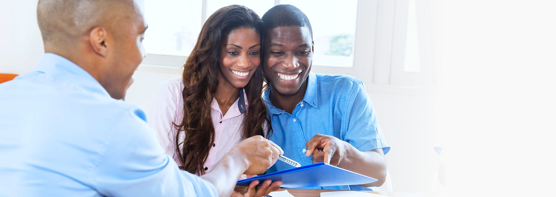 man shows papers to couple