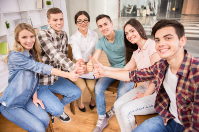 Addicted people having good time together on special group therapy