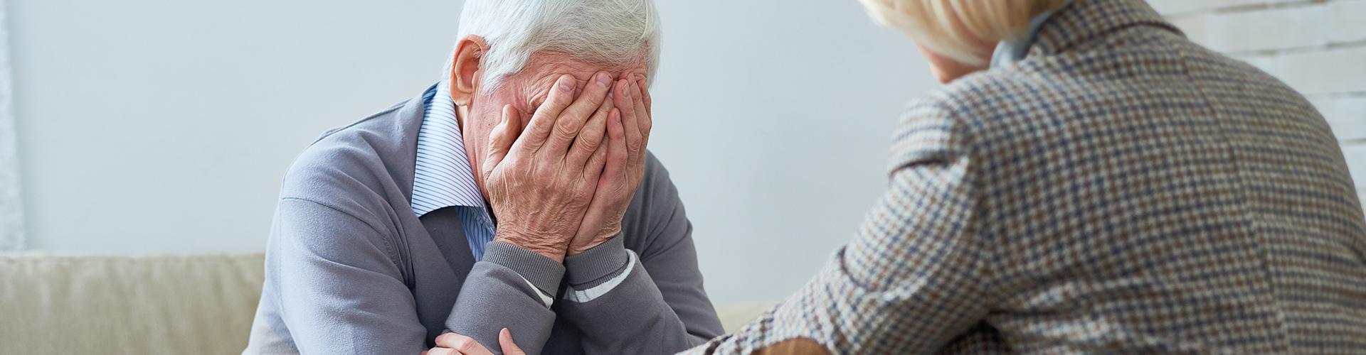 therapist comforts elder patient