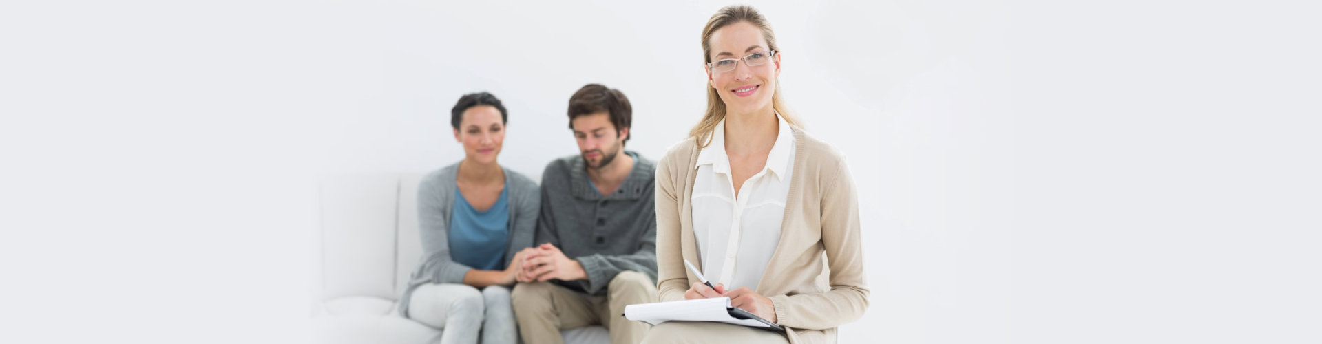 Psychiatrist with patients behind sitting on the chair