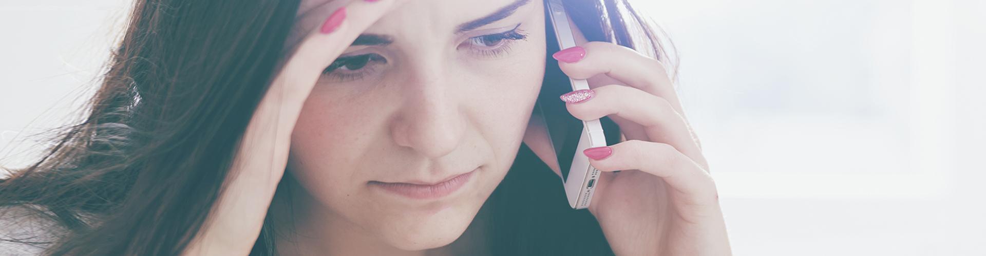 sad woman on phone